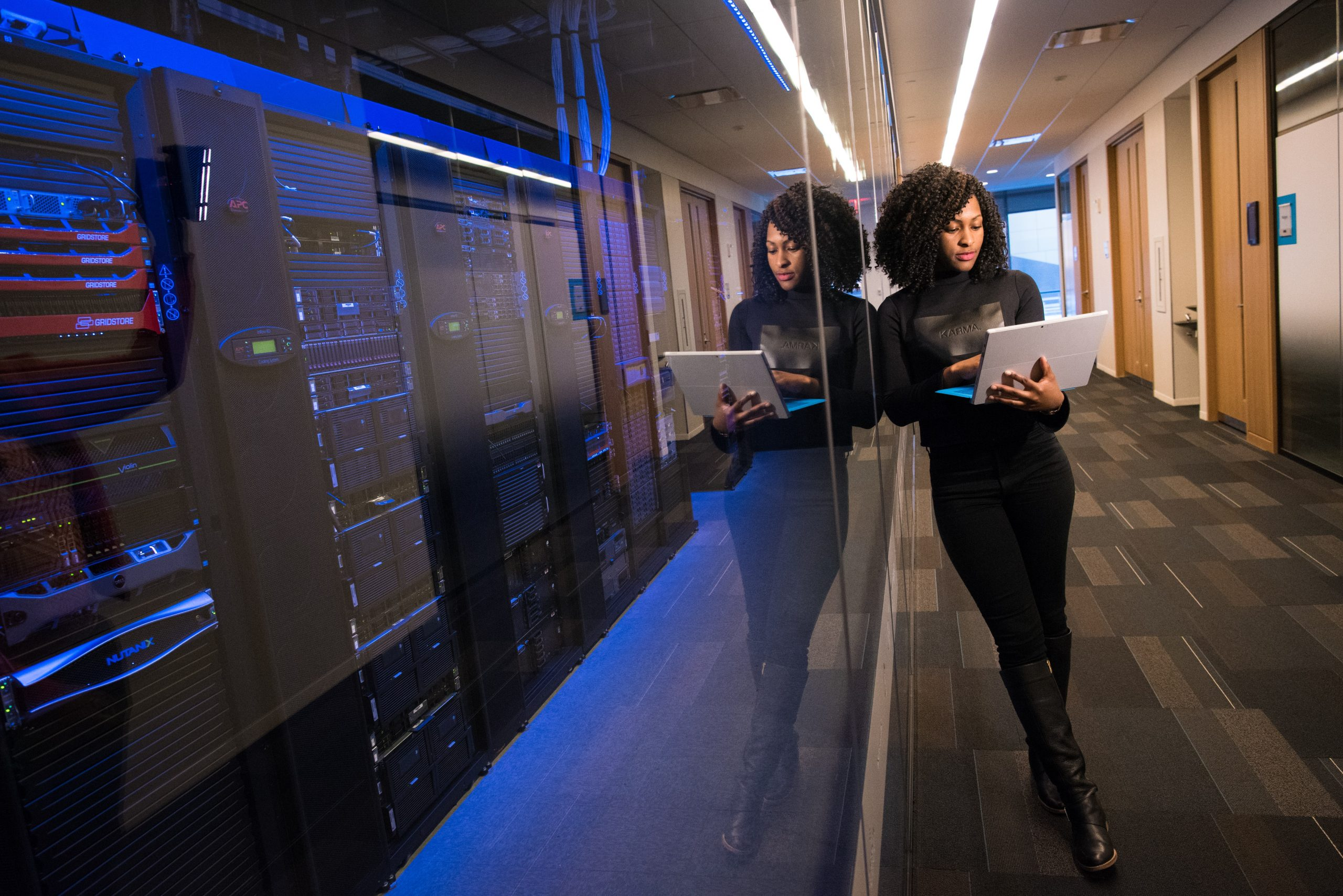 Woman in cloud hosting data center