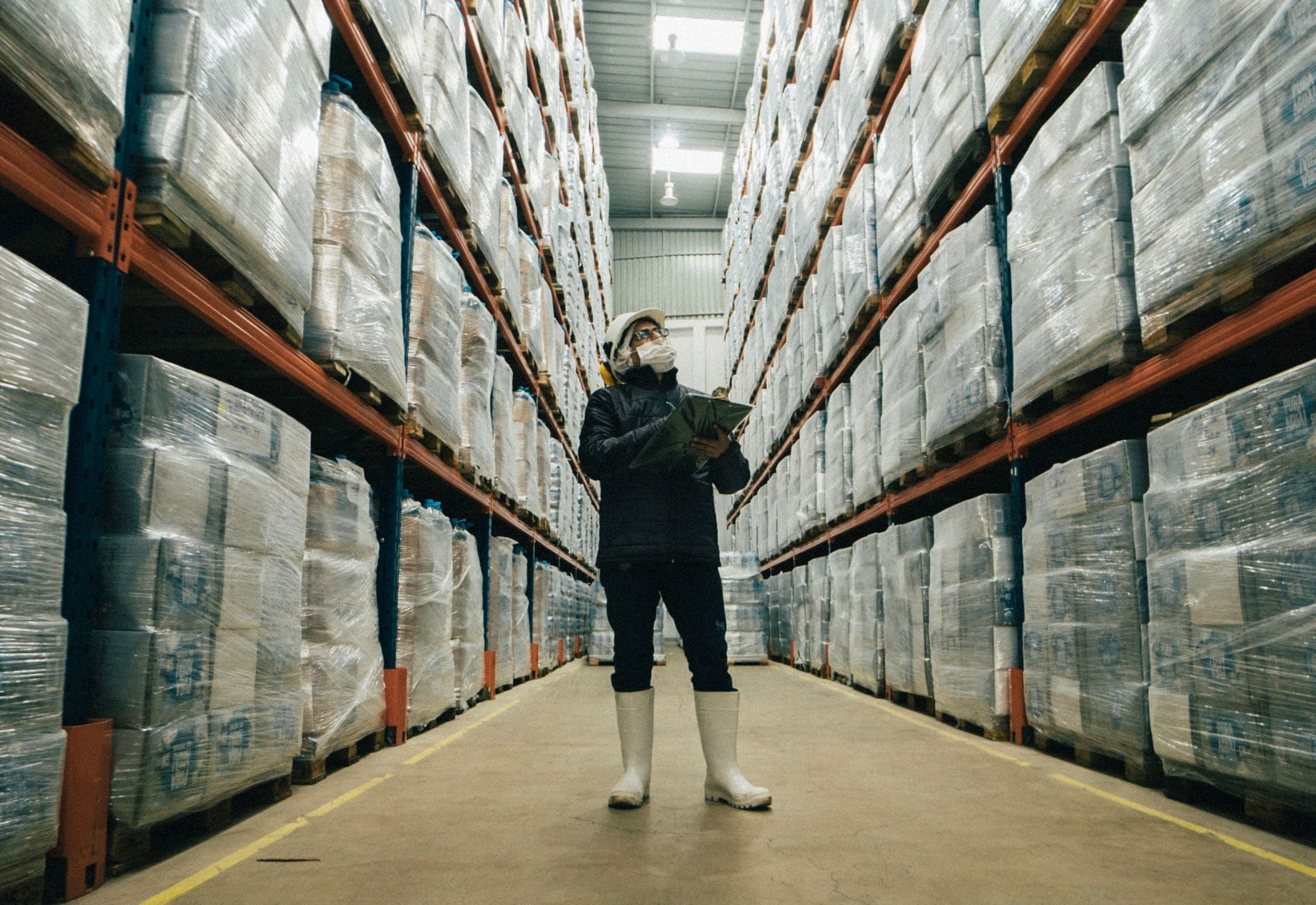 Employee conducts inventory management check in for manufacturer or distributor.
